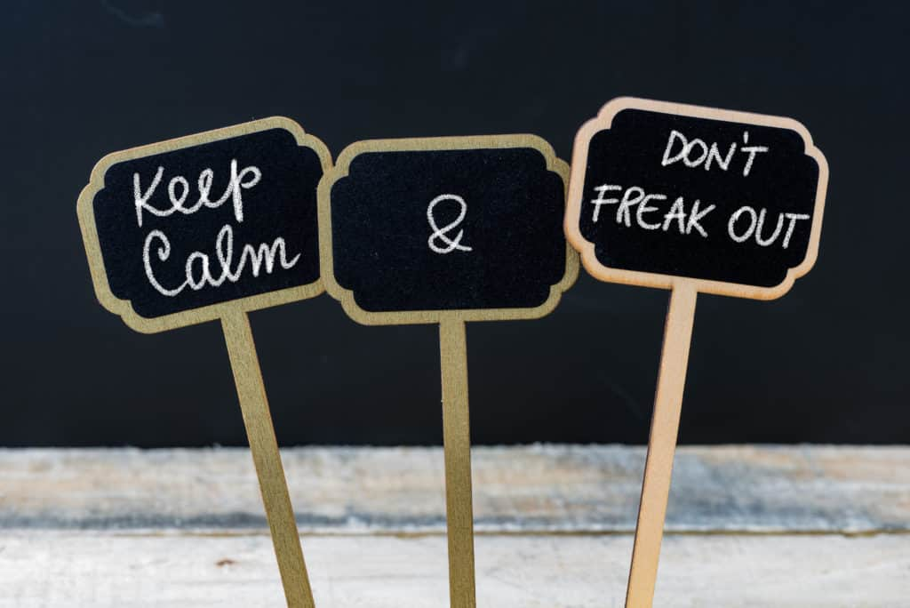 Keep Calm and Do Not Freak Out message written with chalk on mini blackboard labels