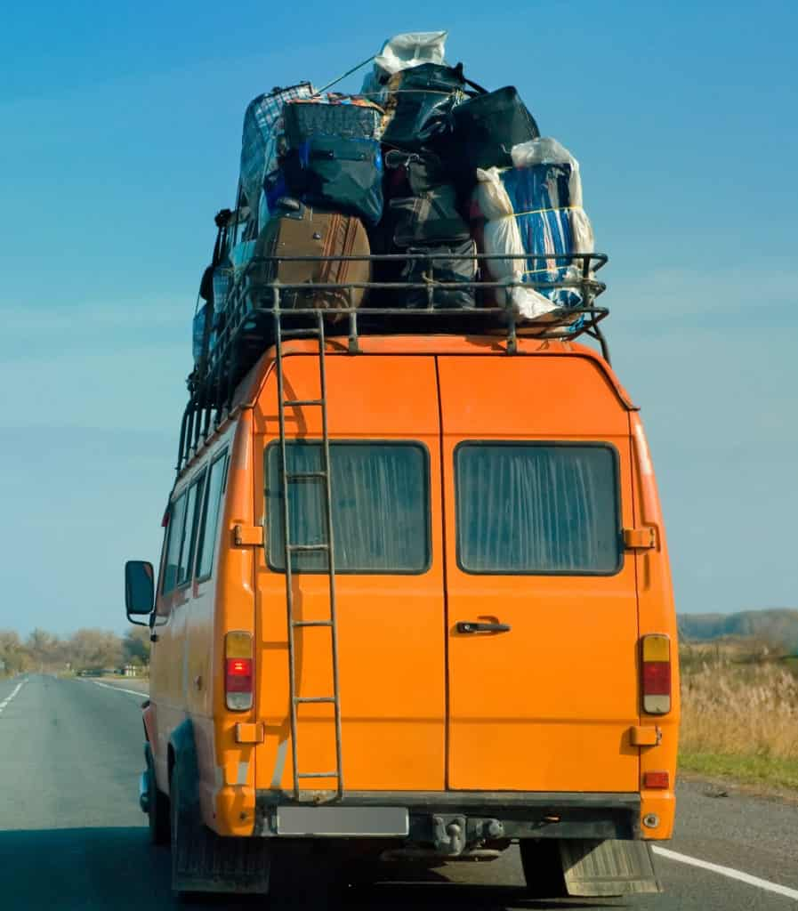Orange van with luggage on top did not use road trip packing list