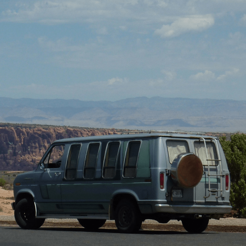 Van by the mountains