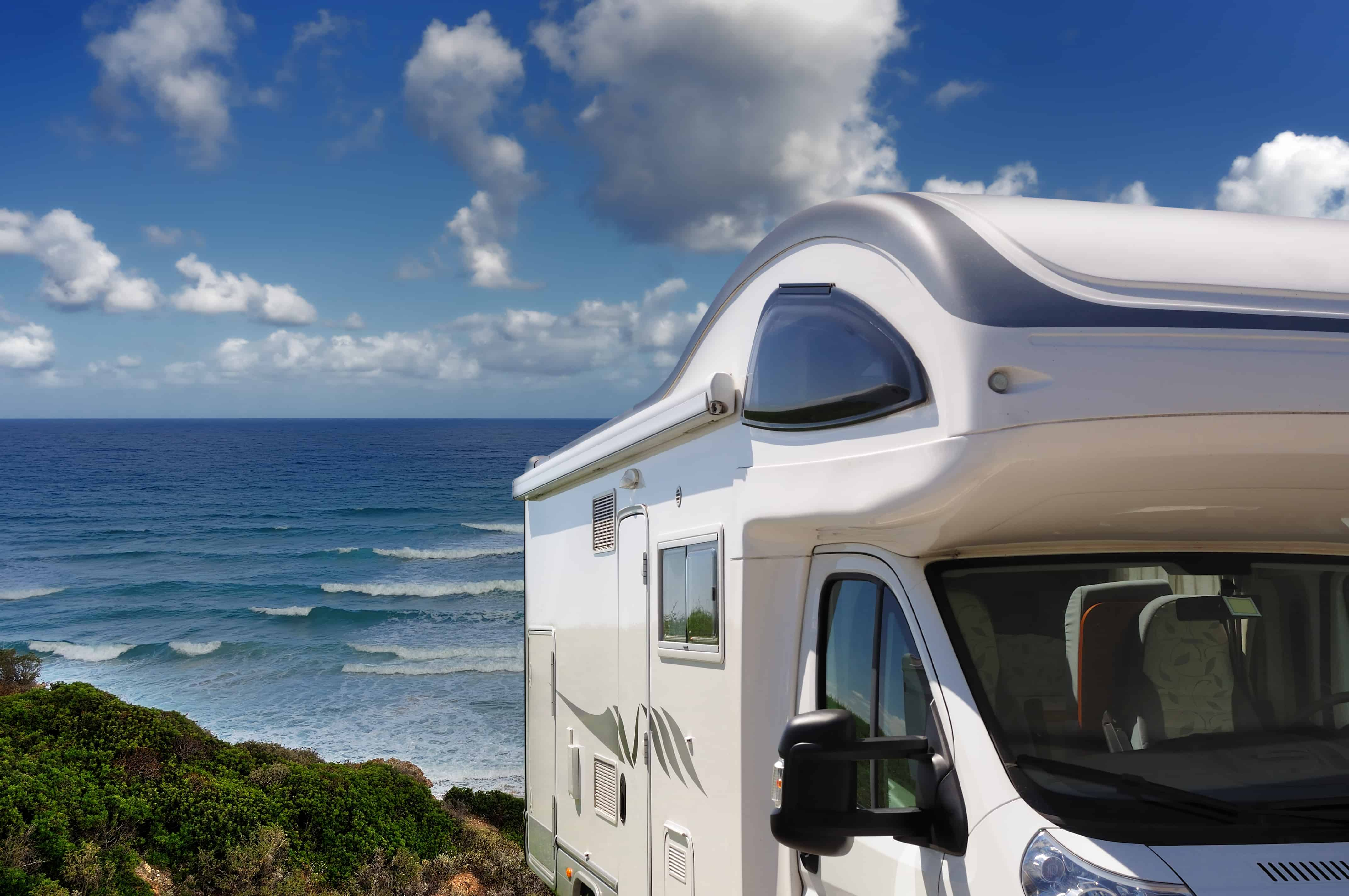 Camping Car parked on the beach.