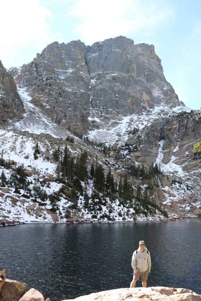 Man standing at the Emerald Lake Trail in Rocky Mountain National Park