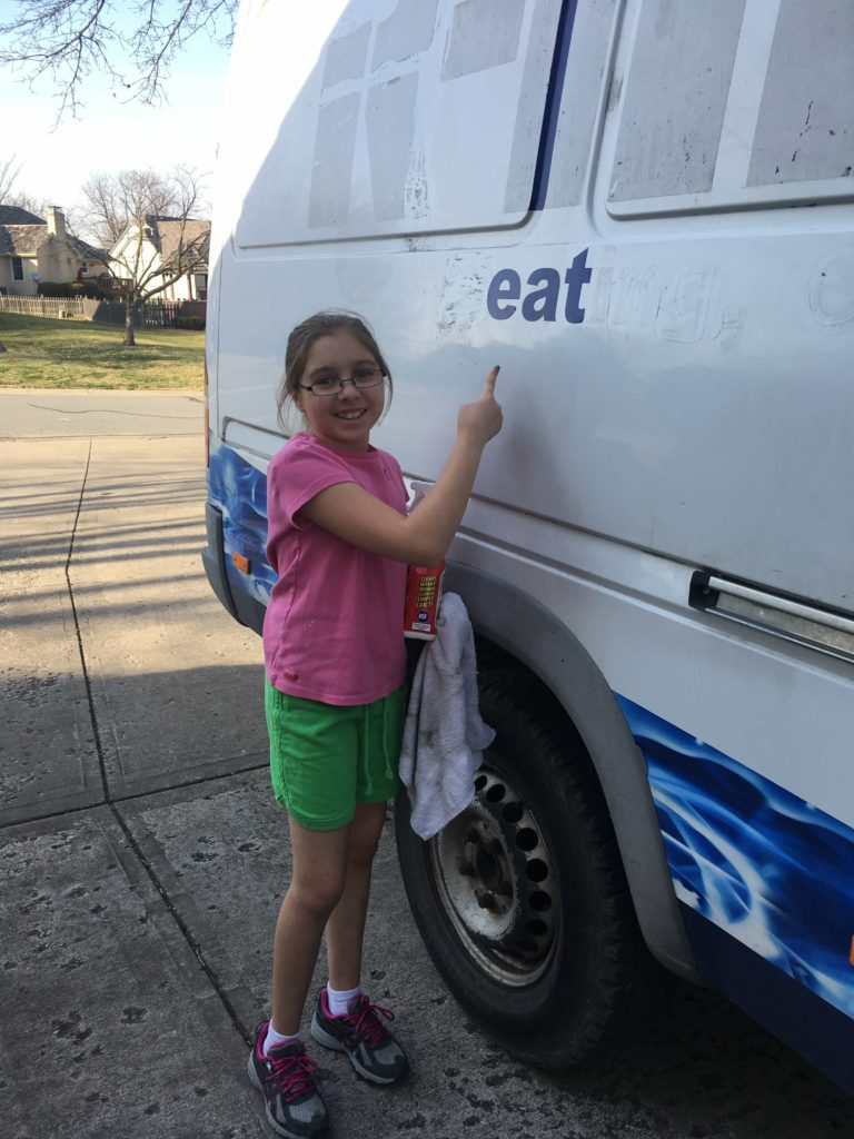 Little Girl with Vinyl Lettering on Sprinter Van