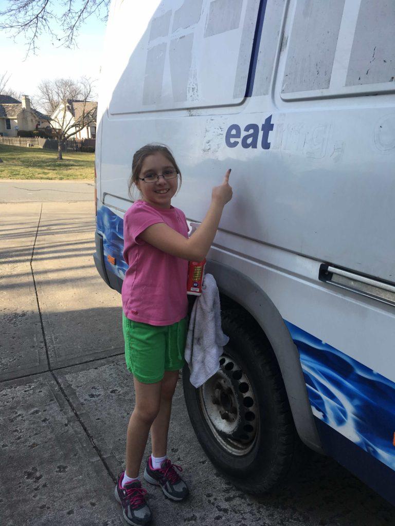 Little Girl with Vinyl Lettering on Sprinter Van