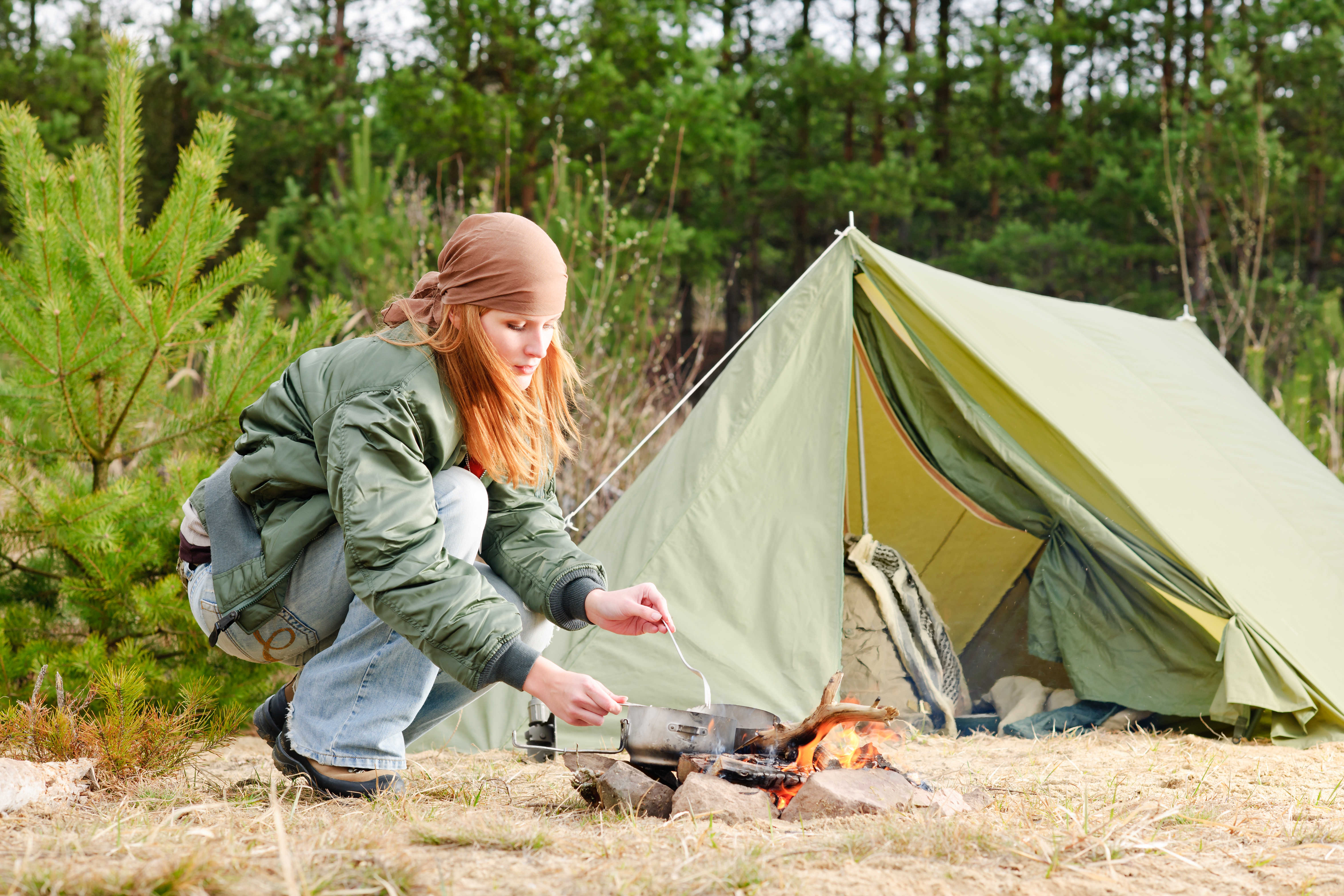 Camping happy woman cook food fire tent nature