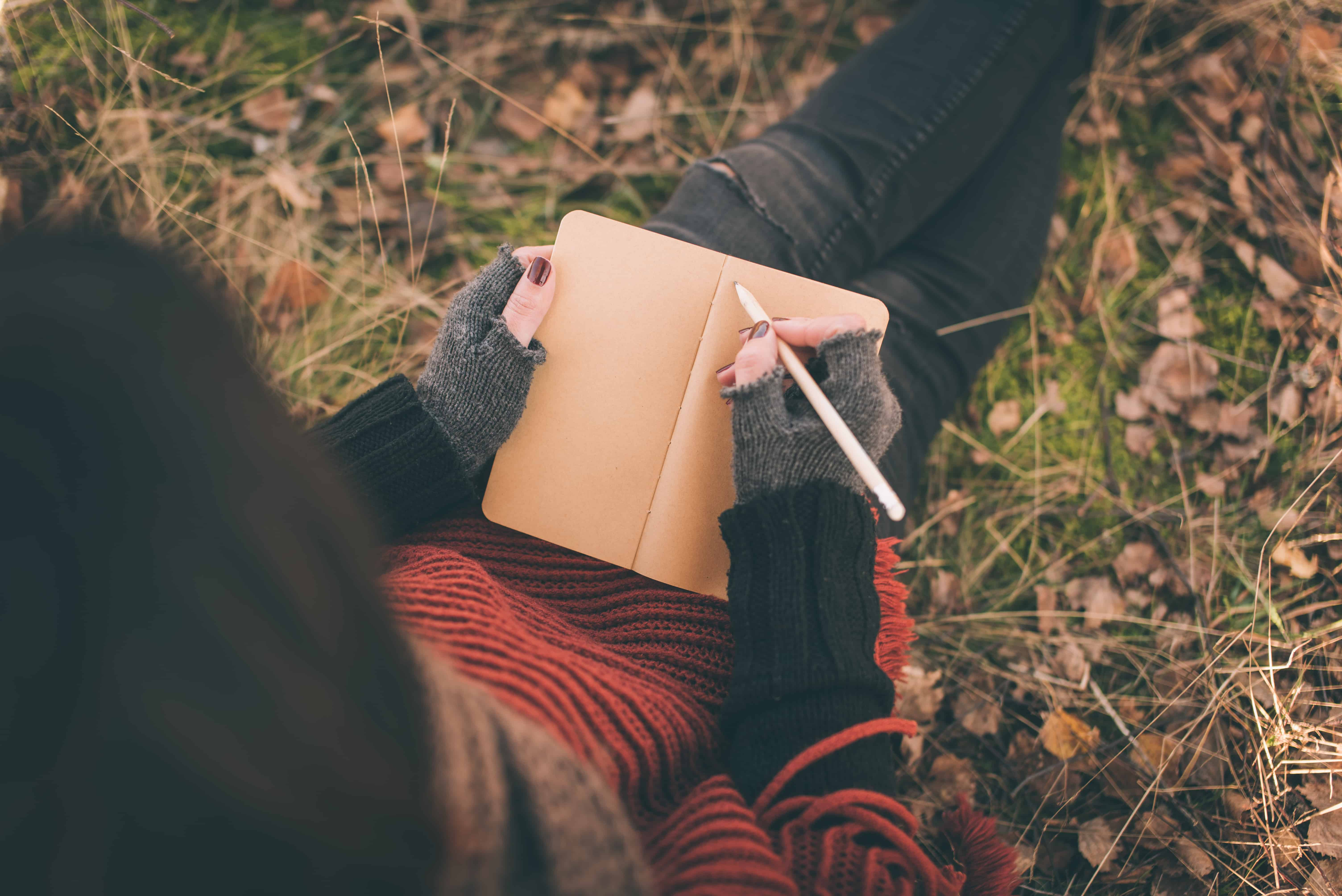 journal with woman writing